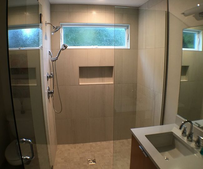 Large curbless shower with glass door