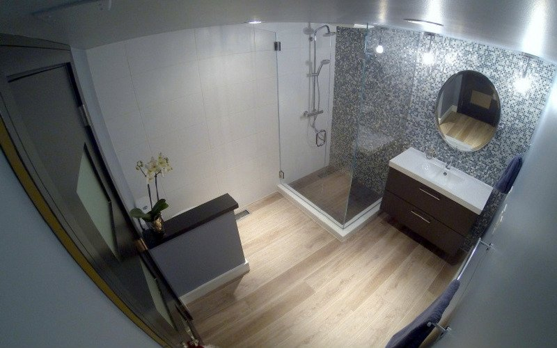 Grey walled bathroom with light-colored wood floors