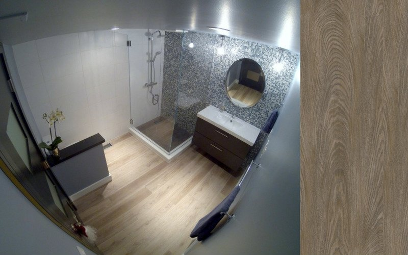 Grey bathroom with light colored wood flooring