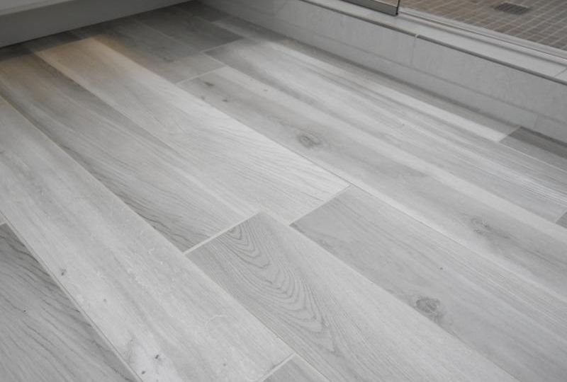 Grey luxury vinyl tile with woodgrain look