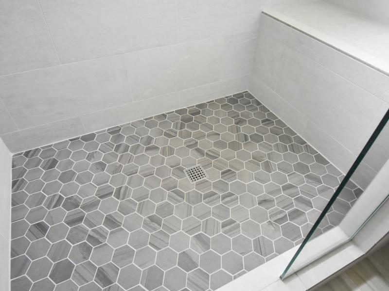 Hex tile on shower floor with seat