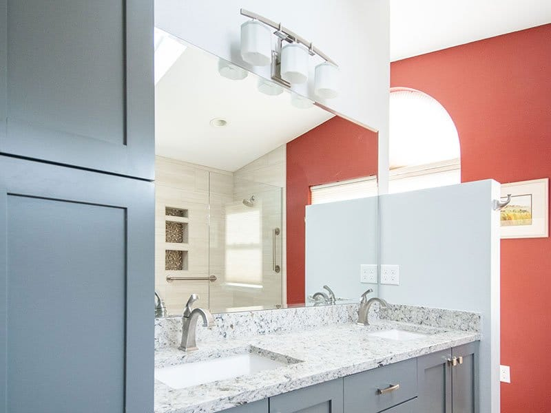 Remodeled bathroom with quartz countertop and partial wall